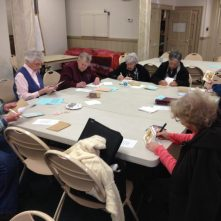 The Seniors at a local church helped sign Christmas cards.