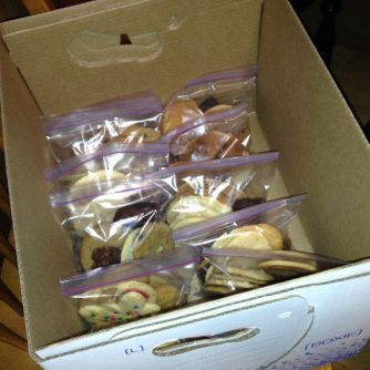 Each bag had at least ten cookies, and the packed cookies were careful packed into boxes for transporting to the jails.