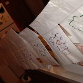 Doug, Hannah, and I sat around our table into the wee hours, decorating bags. We strung them up around the house to dry.