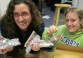 Hannah and Samantha got a little giddy after filling 400 bags with candy.