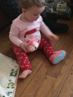Lucy liked her Christmas fox slippers.