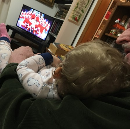 Just relaxing in her Poppa's arms.